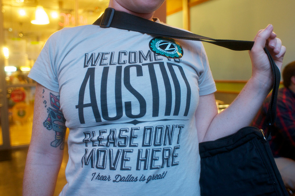 "T-shirt on girl reads ""Welcome to Austin. Please don't move here."""